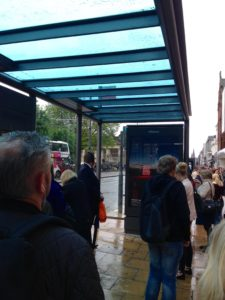 Queue at the bus stop